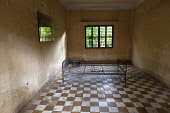 Cambodia, Phnom Penh, One of the cells at Toul Sleng Genocide Museum S-21. Toul Sleng, a high school, was taken over by the Khmer Rouge and turned into a prison, where people were tortured and murdere...