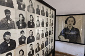 Cambodia, Phnom Penh, Victims' photos, including one of a sad mother and probably her dead baby, at Toul Sleng Genocide Museum Security Prison-21 S-21. Toul Sleng was a high school, taken over by the...