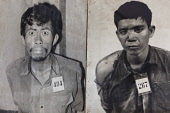 Cambodia, Phnom Penh, Two victims' photos at Toul Sleng Genocide Museum Security Prison-21 S-21. Toul Sleng was a high school, taken over by the Khmer Rouge and turned into a prison, where people were...