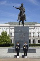 Poland, Warsaw, Old Town, Krakowskie Przedmiescie, Radziwill Palace Presidential Residence with guards in front of statue of Prince Jalzef Poniatowski.