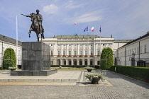 Poland, Warsaw, Ul Krakowskie Przedmiescie or The Royal Way, Radziwill Palace, Presidential Residence with a statue of Prince Józef Poniatowski in front.