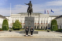 Poland, Warsaw, Poland, Warsaw, Ul Krakowskie Przedmiescie or The Royal Way, Radziwill Palace, Presidential Residence with a statue of Prince Józef Poniatowski and 2 guards in front.