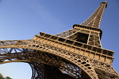 France, Ile de France, Paris. Angled view looking up at The Eiffel Tower.