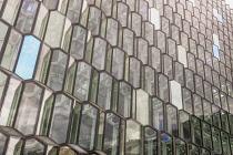 Iceland, Reykjavik, Glass front exterior of Harpa Concert Hall and Conference Centre.