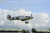 England, West Sussex, Chichester, Goodwood, Hawker Hurricane MK IIb AG 244 in the colours of th Rhodesian Air Force  landing  during the Battle of Britain celebrations 15 September 2015.