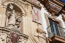 Spain, Andalucia, Cordoba, Statue on the facade of the Antiguo Convento de la Merced.