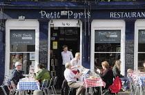Scotland, Edinburgh, Grassmarket, Petit Paris restaurant with diners eating outside..