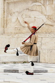 Greece, Attica, Athens, Greek soldier, an Evzone, beside Tomb of the Unknown Soldier, outside Parliament building.