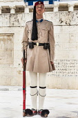 Greece, Attica, Athens, Greek soldier, an Evzone, on sentry duty outside the Parliament building.