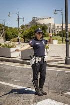 Italy, Sardinia, Olbia, Policewoman.