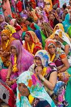 India, Madhya Pradesh, Omkareshwar, A group of female pilgrims at a prayer gathering in Omkareshwar.