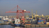 Ireland, County Dublin, Dublin Ferryport, cranes and freight containers seen from departing ferry vessel.