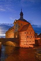 Germany, Bavaria, Bamberg, Altes Rathaus or Old Town Hall, Floodlit at dusk.