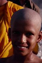 Sri Lanka, Arambegama, Portrait of young novice monk after having had his head shaved during ordination ceremony.