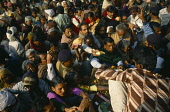 India, West Bengal, Sagar Island, Crowds of pilgrims with offerings at the temple to sage Kapil Muni on the island also known as Sagardwip.