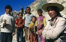 China, Tibet, Shigatse, Family of pilgrims stood on the Tashilhunpo Kora or pilgrims way.