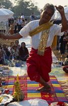 Cambodia, Siem Reap, Angkor Wat, Shaman dancing in a trance at ceremony