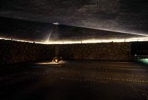 Israel, Jerusalem, Yad Vashem Holocaust memorial and museum interior with eternal flame.