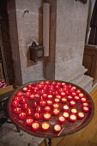 Portugal, Estredmadura, Lisbon, Alfama district, Votive candles in Church of Sao Vicente of Fora.