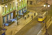 Portugal, Estredmadura, Lisbon, Baixa, Praca da Figueira, Tram parked at night.