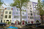 Holland, North, Amsterdam, Colourful modern canalside buildings.