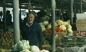 Qatar, Doha, The Souk or market with man selling vegetables at his stall.