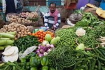 India, Uttar Pradesh, Varanasi, A vegetable vendor.