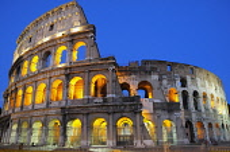 Italy, Lazio, Rome, Colosseum lit at night.