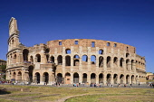 Italy, Lazio, Rome, The Colosseum amphitheatre built by Emperor Vespasian in AD 80, View of the full south side with tourists both inside and outside.