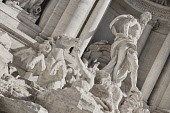 Italy, Lazio, Rome, Piazza di Trevi, Baroque Trevi Fountain or Fontana di Trevi showing statue of the Greek God Oceanus with his chariot being pulled by sea horses.