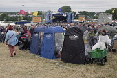 England, Oxfordshire, Three fold out chairs with weather proof plastic covers at Cropredy festival.