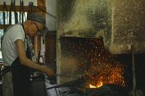 Japan, Traditional Blacksmith at work.