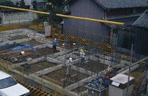 Japan, Honshu, General, Men working on construction of building foundations.