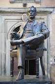 Italy, Tuscany, Lucca, Bronze statue of Giacomo Puccini in front of his birthplace Casa natale, now a museum.