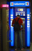 Germany, Berlin, Mitte, Automated currency exchange machine.