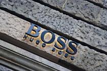 Germany, Berlin, Mitte, Friedrichstrasse, Hugo Boss fashion shop sign.