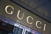 Germany, Berlin, Mitte, Friedrichstrasse, Illuminated Gucci fashion shop sign.