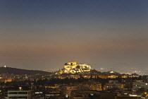 Greece, Attica, Athens, Acropolis, Parthenon illuminated at night.