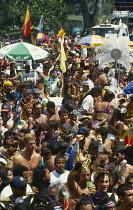 West Indies, Trinidad, General, Carnival crowds and dancers.