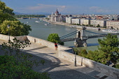 Hungary, Budapest, View across the River Danube to the Hungarian Parliament Building from Castle Hill with the Chain Bridge in the foreground.