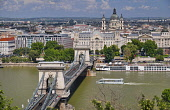 Hungary, Budapest, Szechenyi Chain Bridge across the River Danube with St Stephens Basilica as seen from Castle Hill.