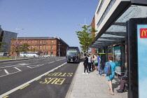 Ireland, North, Belfast, Titanic Quarter, Tourists awaiting Glider rapid transit bus.