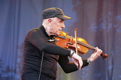 England, Oxfordshire, Cropredy, Geoff Richardson of Caravan playing fiddle at the festival.