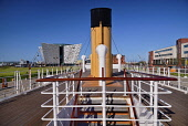Ireland, County Antrim, Belfast, Titanic Quarter, Titanic Belfast visitor attraction seen from the upper deck of the restored SS Nomadic a former tender for the White Star Line shipping company  that...