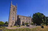 Ireland, County Down, Downpatrick, Cathedral Church of the Holy Trinity also known as Down Cathedral with Mourne granite slab marking the traditional burial place of St Patrick in the foreground.