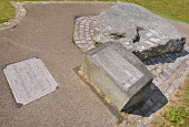 Ireland, County Down, Downpatrick, Mourne granite slab marking the traditional burial place of St Patrick at the Cathedral Church of the Holy Trinity also known as Down Cathedral.