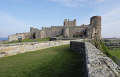 England, Northumberland, Bamburgh Castle on rocky outcrop.