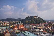 Slovenia, Ljubljana, Vista of the city towards Ljubljana Castle from the 12th floor viewing terrace of  the Neboticnik or Skyscraper Building.