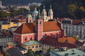 Slovenia, Ljubljana, Vista of the city from the 12th floor viewing terrace of  the Neboticnik or Skyscraper Building with the Franciscan Church of the Annunciation and the Cathedral of St Nicholas pro...