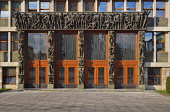 Slovenia, Ljubljana, Slovenian Parliament Building, Main entrance portal with four oak doors surrounded with statues by Zdenko Kalin and Karel Putrih which represent working people and aspects of thei...